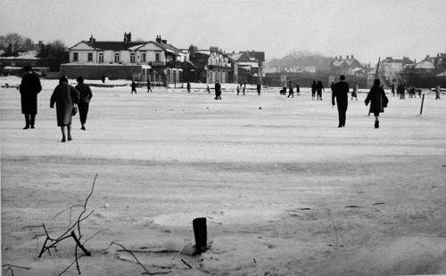 Skating on the ice on the Thames in Windsor, 1963.